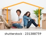 smiling young couple sitting... | Shutterstock . vector #231388759