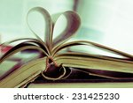 Small photo of Vintage of book pages, heart shaped