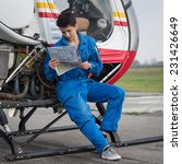 Young Woman Helicopter Pilot...