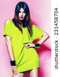 sexy woman in neon green dress... | Shutterstock . vector #231458704