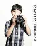 A Young Boy Photographer Over...