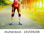 tired woman runner taking a... | Shutterstock . vector #231534238