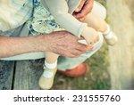 baby girl holding finger of... | Shutterstock . vector #231555760