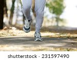 young man jogging at park | Shutterstock . vector #231597490