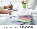 designer working at desk using...