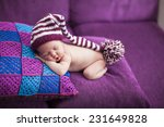 newborn baby girl in a knitted... | Shutterstock . vector #231649828