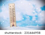 thermometer on snow shows low... | Shutterstock . vector #231666958