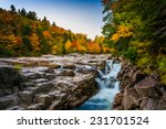 Autumn Color And Waterfall At...