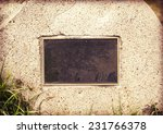 A Weathered Plaque Embedded In...