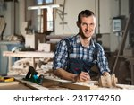 young craftsman in uniform... | Shutterstock . vector #231774250