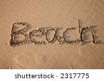the word beach  written in sand. | Shutterstock . vector #2317775