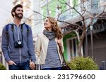 young couple on holiday walking ... | Shutterstock . vector #231796600