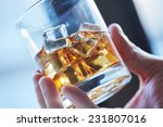 glass of whiskey with ice in... | Shutterstock . vector #231807016