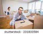 cute couple unpacking cardboard ...   Shutterstock . vector #231833584