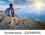 young woman standing on a rock... | Shutterstock . vector #231948943