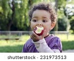 child girl eating an apple in a ... | Shutterstock . vector #231973513