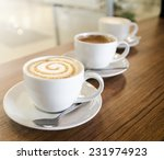 Three Coffee Cups With...