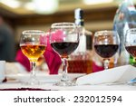 table arrangement with wine... | Shutterstock . vector #232012594