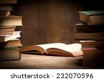 old book open on a wooden table  | Shutterstock . vector #232070596