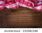 top view of checkered napkin on ... | Shutterstock . vector #232082188