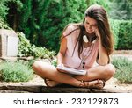 young beautiful female sitting... | Shutterstock . vector #232129873