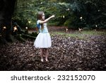 A Young Shy Child Girl With...