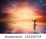 Woman Stands In Praise Before A ...