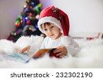 Cute Adorable Boy Reading A...