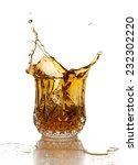 Whiskey Splash On Elegant Glas...