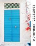 turkey blue door with white wall | Shutterstock . vector #232310986