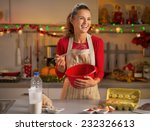 happy young housewife whisking... | Shutterstock . vector #232326613