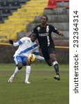 Small photo of BUDAPEST, HUNGARY - NOVEMBER 22, 2014: Thiam Khaly Iyane of MTK (l) and Georges Griffiths of DVTK watch the ball during MTK Budapest vs. DVTK OTP Bank League football match in Bozsik Stadium.