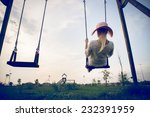 Woman On A Swing In A Park  ...