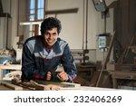 young craftsman in uniform... | Shutterstock . vector #232406269