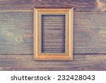 photo frame on wooden... | Shutterstock . vector #232428043