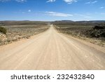 A Namibian Dirt Road Wit A Far...