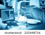 flask in scientist hand with...   Shutterstock . vector #232448716