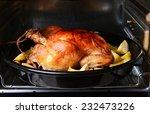 delicious baked chicken in oven ... | Shutterstock . vector #232473226
