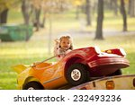 Little Girl Riding A Car In...