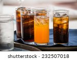 many soft drink are on a tray | Shutterstock . vector #232507018