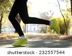 young woman jogging at park | Shutterstock . vector #232557544