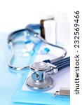 stethoscope on light blue... | Shutterstock . vector #232569466