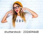 fashion studio portrait of... | Shutterstock . vector #232604668