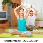 happy young couple having yoga