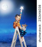 Young Boy Holding A Bright Star