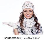 beautiful woman in warm... | Shutterstock . vector #232694110