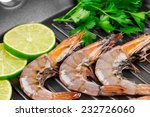 raw shrimps on black pan. whole ... | Shutterstock . vector #232726060