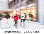 a young shoppers walking... | Shutterstock . vector #232774156