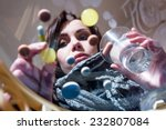 girl looking at colorful pills | Shutterstock . vector #232807084