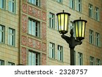 historic streetlamp in front of historic building - stock photo